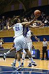 27 October 2013: Oderah Chidom (in blue) is fouled by Kendall McCravey-Cooper (21). The Duke University Blue Devils played their annual preseason Blue White women's college basketball game at Cameron Indoor Stadium in Durham, North Carolina.