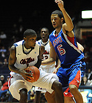 Mississippi's Terrance Henry (1) is defended by SMU's Cannen Cunningham (15) at the C.M. &quot;Tad&quot; Smith Coliseum in Oxford, Miss. on Tuesday, January 3, 2012. (AP Photo/Oxford Eagle, Bruce Newman)