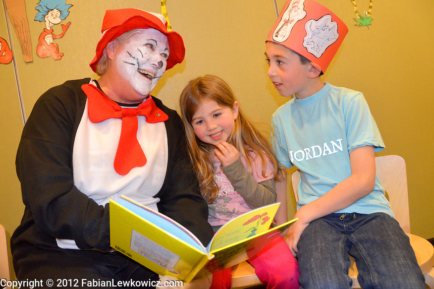 The Cat in the Hat, Kiwanian Dr. Janie Jones Harding, reads, Theres a Wocket in my Pocket! to Katelyn Kloss, 4, and her brother Kadin, 7, at the Santa Monica Public Library during  Kiwanis Club of Santa Monica's  fourth annual Seuss-tastic day on Saturday, March 3, 2012.