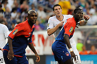 Kenny Cooper (17) of the United States (USA) fights for position with Pierre Bruny (13) of Haiti (HAI). The United States and Haiti played to a 2-2 tie during a CONCACAF Gold Cup Group B group stage match at Gillette Stadium in Foxborough, MA, on July 11, 2009. .