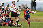 Refferee Nigel Bradley watches as Jon-Paul Fonoimoana passes from a ruck. Counties Manukau Premier Club Rugby game between Manurewa and Ardmore Marist played at Mountfort Park, Manurewa on Saturday June 19th 2010..Manurewa won the game 27 - 10 after leading 15 - 5 at halftime.