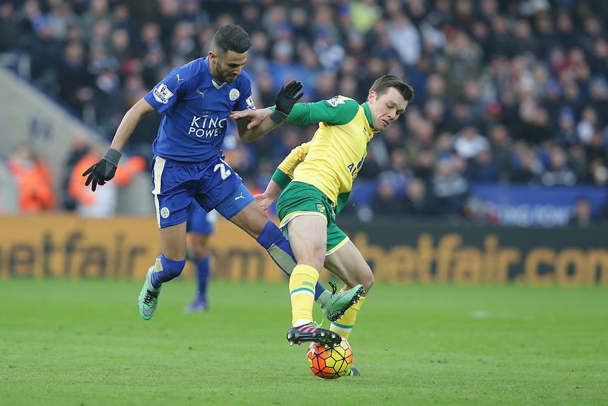 Leicester City's Riyad Mahrez and Norwich City's Jonathan Howson<br /> <br /> Photographer Stephen White/CameraSport<br /> <br /> Football - Barclays Premiership - Leicester City v Norwich City - Saturday 27th February 2016 - King Power Stadium - Leicester<br /> <br /> &copy; CameraSport - 43 Linden Ave. Countesthorpe. Leicester. England. LE8 5PG - Tel: +44 (0) 116 277 4147 - admin@camerasport.com - www.camerasport.com