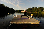 Katie practicing yoga on the pontoon on the lake at Omega Institute, Rhinebeck, New York.