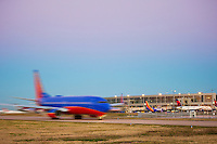 Jet airplane taxiing across the runway at Austin Bergstrom International Airport ABIA, in Austin, Texas.