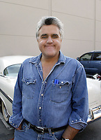 23 May 2003: TV host Jay Leno outside the set of a night taping of NBC's hit The Tonight Show with Jay Leno at the NBC Studios in Burbank, CA near his parking space and a white car.