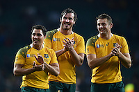 Nick Phipps, Kane Douglas and Dean Mumm of Australia are all smiles after the match. Rugby World Cup Quarter Final between Australia and Scotland on October 18, 2015 at Twickenham Stadium in London, England. Photo by: Patrick Khachfe / Onside Images