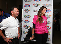 Apr 24, 2015; Baytown, TX, USA; NHRA top fuel driver Steve Torrence (left) with Taya Kyle , wife of slain US Navy sniper Chris Kyle in the pits during qualifying for the Spring Nationals at Royal Purple Raceway. Torrence announced a partnership with the Chris Kyle Frog Foundation. Mandatory Credit: Mark J. Rebilas-