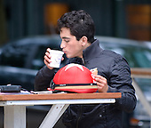 Jockey Miguel Mena enjoys a coffee break at the The Morning line.