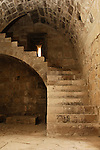 Travel stock photo of a Stone staircase and arched ceiling Interior of medieval castle Kolossi in Cyprus 2007 year