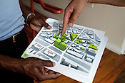 June 6, 2011. Durham, NC. Greenfire employees point out properties that they own in downtown Durham. All the green buildings on the map are owned by them.