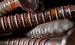 Macro image of rusty screws.