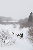 A musher and team travel through rural Alger County near Chatham during the UP 200 Sled Dog Championship race.
