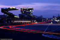 LE MANS, FRANCE - JUNE 20: A time-exposure night view of the front straight of the 1982 24 Hours of Le Mans on June 20, 1982, at Circuit de la Sarthe in Le Mans, France.