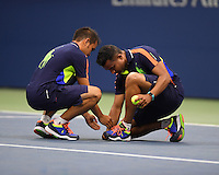 FLUSHING NY- SEPTEMBER 07: Ball boys pick up a Butterfly after Andy Murray swats it with his racket during his match against Kei Nishikori on Arthur Ashe Stadium at the USTA Billie Jean King National Tennis Center on September 7, 2016 in Flushing Queens. Credit: mpi04/MediaPunch