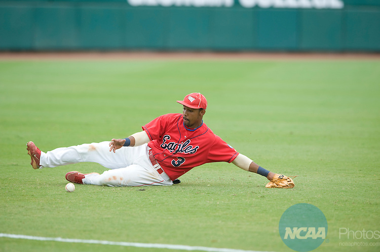 29 MAY 2010: University of Southern Indiana shortstop Wandy Rosario (3) slides to knock down a ground ball against UC-San Diego during the Division II Men's Baseball Championship held at the USA Baseball National Training Complex in Cary, NC.  The University of Southern Indiana defeated UC-San Diego, 6-4, to win the national title.  Grant Halverson/ NCAA Photos