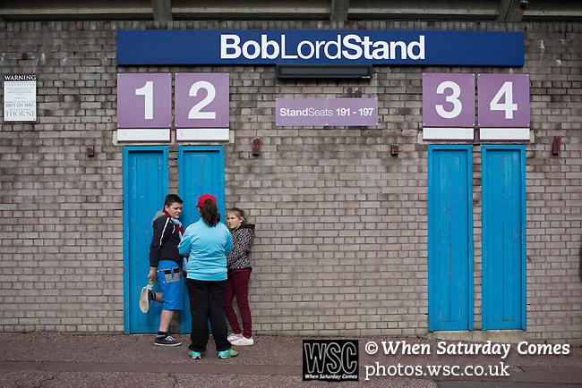 Burnley 1 West Ham United 3, 18/10/2014. Turf Moor, Premier League. Home supporters waiting for the turnstiles to open outside The fixture was won by the visitors by three goals to one watched by 18,936 spectators. The defeat meant that Burnley still had not won a league match since being promoted from the Championship the previous season. Photo by Colin McPherson.