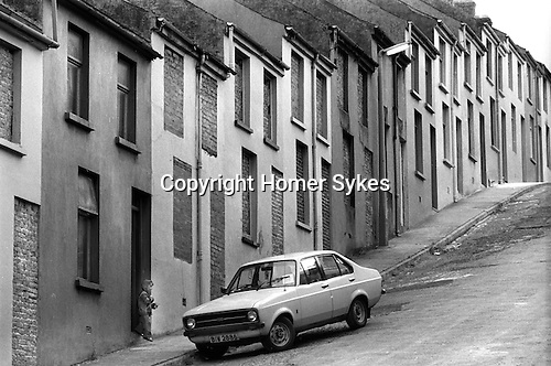 Derry, Northern Ireland. 1979<br /> One family remains in this Waterside street, houses area abandoned and boarded up as families have moved away due to sectarian violence.