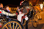 The Wilks and Mahendra-Rajah families prepare for a ride on a horse-drawn carriage during the Los Altos Village Association's Holiday Stroll.