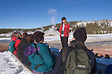Julianne Baker of Yellowstone Association Institute telling winter visitors about geothermal activity in the Upper Geyser area of Yellowstone National Park. .#D0401421