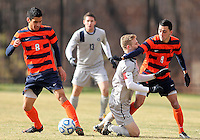 WASHINGTON, DC - NOVEMBER 25, 2012: Ian Christianson (6) of Georgetown University is beaten by Nick Perea (8) and Stefanos Stamoulacatos (9) of Syracuse University during an NCAA championship third round match at North Kehoe field, in Georgetown, Washington DC on November 25. Georgetown won 2-1 after overtime and penalty kicks.