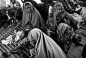 Somali refugees seen with their children inside a stabilization centre where she is given plumpy nut supplement in IFO-1camp in the Dadaab refugee camp in northeastern Kenya. Photo: Sanjit Das/Panos