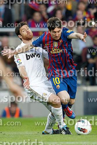 21.04.2012, Stadion Camp Nou, Barcelona, ESP, Primera Division, FC Barcelona vs Real Madrid, 35. Spieltag, im Bild Barcelona's Lionel Messi and Real Madrid's Xabi Alonso // during the football match of spanish 'primera divison' league, 35th round, between FC Barcelona and Real Madrid at Camp Nou stadium, Barcelona, Spain on 2012/04/21. EXPA Pictures © 2012, PhotoCredit: EXPA/ Alterphotos/ Cesar Cebolla..***** ATTENTION - OUT OF ESP and SUI *****