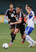 D.C. United forward Chris Pontius (13) goes against Montreal Impact midfielder Sinisa Ubiparipovic (28) D.C. United defeated Montreal Impact 3-0 at RFK Stadium, Saturday June 30, 2012.