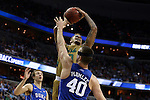 10 March 2016: Notre Dame's Zach Auguste (behind) is fouled by Duke's Marshall Plumlee (40). The University of Notre Dame Fighting Irish played the Duke University Blue Devils at the Verizon Center in Washington, DC in the Atlantic Coast Conference Men's Basketball Tournament quarterfinal and a 2015-16 NCAA Division I Men's Basketball game. Notre Dame won the game 84-79 in overtime.