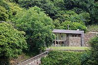 The garden facade of a secluded luxury holiday home on the Fowey estuary in Cornwall