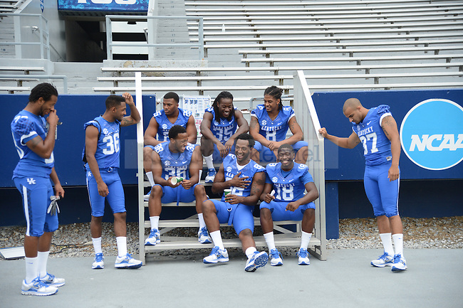 Players wait around during UK Football Media Day on Friday, August 3, 2012. Photo by Mike Weaver| Staff