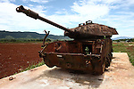 The rusted-out shell of an American M-48 tank sits on display beside the former airstrip at Khe Sanh, Vietnam. April 24, 2013.