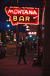 neon lights of bar sign at dusk in miles city, montana