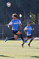 July 16, 2009. UCLA Campus, Los Angeles, CA: An Inter Milan soccer player takes a header in their exhibition match against UCLA.