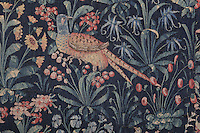 Pheasant and flowers, from the St Eloi tapestry, Flemish, early 16th century, in Les Hospices de Beaune, or Hotel-Dieu de Beaune, a charitable almshouse and hospital for the poor, built 1443-57 by Flemish architect Jacques Wiscrer, and founded by Nicolas Rolin, chancellor of Burgundy, and his wife Guigone de Salins, in Beaune, Cote d'Or, Burgundy, France. The hospital was run by the nuns of the order of Les Soeurs Hospitalieres de Beaune, and remained a hospital until the 1970s. The building now houses the Musee de l'Histoire de la Medecine, or Museum of the History of Medicine, and is listed as a historic monument. Picture by Manuel Cohen