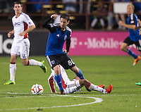 Santa Clara, California -Saturday, March 29, 2014: Jean-Baptiste Pierazzia of SJ Earthquakes keeps his composure while being tackled by NE Revolution defender during a match at Buck Shaw Stadium. Final Score: SJ Earthquakes 1, NE Revolution 2