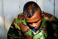 An AUC paramilitary fighter waiting for demobilization in a jungle settlement Casibare, in the Meta Department, Colombia, 9 April 2006.