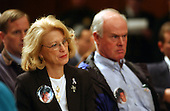 Washington, D.C. - March 23, 2004 -- Elaine Hughes, left and Henry Hughes, right, of Long Island, New York, whose son, Kris Robert Hughes, was on the 89th floor of the South Tower of the World Trade Center on September 11, 2001, listen to testimony before the National Commission on Terrorist Attacks Upon the United States (9/11 Commission) during its 8th Public Hearing in Washington, D.C. on March 23, 2004.<br /> Credit: Ron Sachs / CNP<br /> [RESTRICTION: No New York Metro or other Newspapers within a 75 mile radius of New York City]
