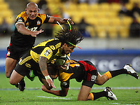 Cheifs' Richard Kahui and Sona Taumalolo tackle Ma'a Nonu during the Super 14 rugby match between the Hurricanes and Chiefs at Westpac Stadium, Wellington, NewZealand on Saturday, 1 May 2010. Photo: Dave Lintott / lintottphoto.co.nz