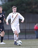 Boston College midfielder Jason Abbott (6) brings the ball forward. Brown University (black) defeated Boston College (white), 1-0, at Newton Campus Field, October 16, 2012.