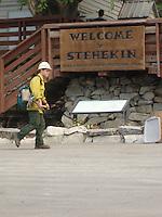 A firefighter walks in front of the Stehekin Ranger Station.