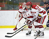 Eric Kroshus (Harvard - 10) - The visiting Quinnipiac University Bobcats defeated the Harvard University Crimson 3-1 on Wednesday, December 8, 2010, at Bright Hockey Center in Cambridge, Massachusetts.