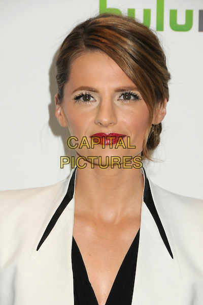 """Stana Katic.PaleyFest 2012 Presents """"Castle"""" held at The Saban Theatre, Beverly Hills, California, USA, 9th March 2012..portrait headshot lipstick hair up  jacket white  black red .CAP/ADM/BP.©Byron Purvis/AdMedia/Capital Pictures."""