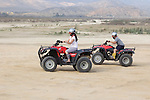 Couple riding Quads on the playa near Migrino, Baja California, Mexico