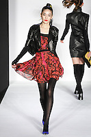 Sayyora walks runway in a bebeBlack Fall 2011 outfit, at the Style 360 Fall 2011 fashion show, during New York Fashion Week.