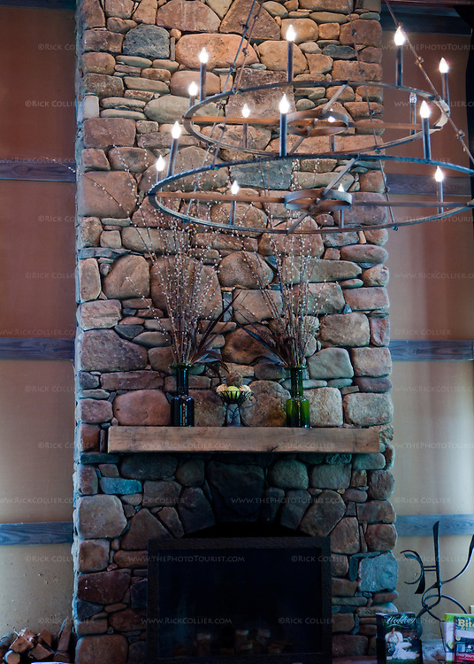 The tasting room at Veritas Vineyards features a beatiful, rustic stone fireplace at one end, which is clearly used in winter.
