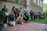 """Many of the employees of the financial aid department wait in preparation to complete the """"Ice Bucket Challenge"""" in honor of Vicky Boyles, a coworker who was forced to leave her work as the Assistant Director of Financial Aid at the end of last March due to her battle against PMA. The group gathered behind Chubb Hall on College Green on Wednesday, August 27, 2014. Photo by Katelyn Vancouver"""