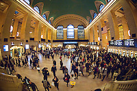 Travelers crowd Grand Central Terminal in New York on Wednesday, November 23, 2011, the beginning of the great exodus over the Thanksgiving weekend.  According to AAA,  travel will increase 4 percent from last year. Unemployment is expected to be 0.4 points less than last year.  (© Frances M. Roberts)