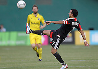 WASHINGTON, DC - AUGUST 4, 2012:  Dwayne DeRosario (7) of DC United makes a high kick against the Columbus Crew during an MLS match at RFK Stadium in Washington DC on August 4. United won 1-0.