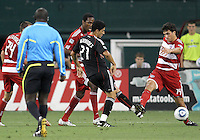 Pablo Hernandez #21 of D.C. United and George John #14 of FC Dallas go for a loose ball during an MLS match at RFK Stadium in Washington D.C. on August 14 2010. Dallas won 3-1.