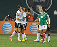 Sydney Leroux (2) of the USWNT celebrates with teammate Abby Wambach one of her 4 goals. The USWNT defeated Mexico 7-0 during an international friendly, at RFK Stadium, Tuesday September 3, 2013.